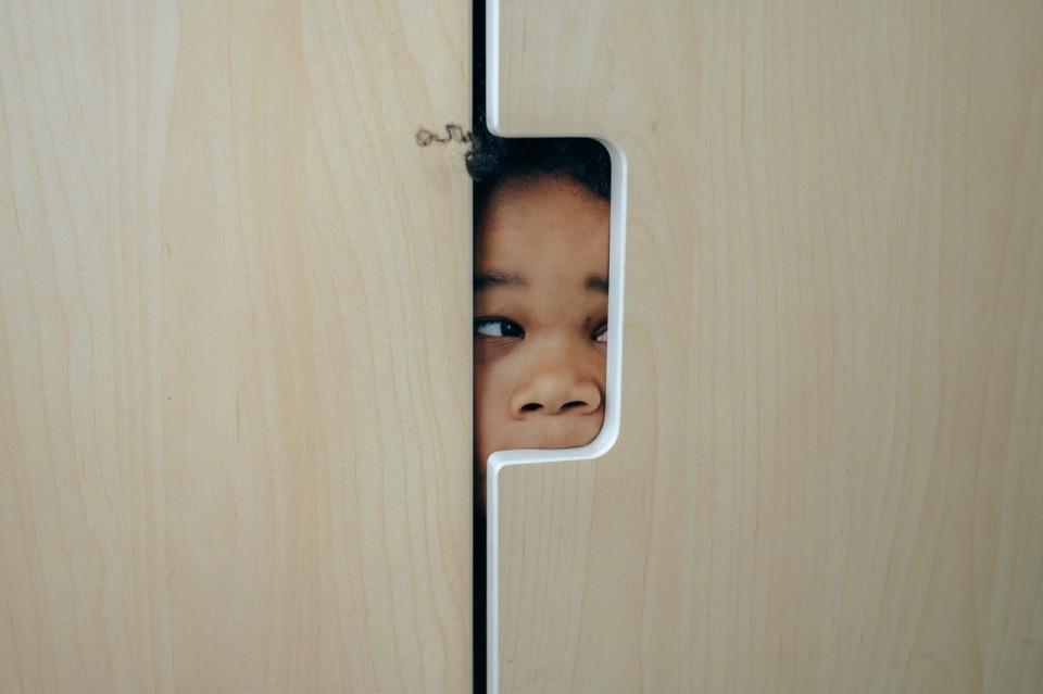 girl hiding in a closet