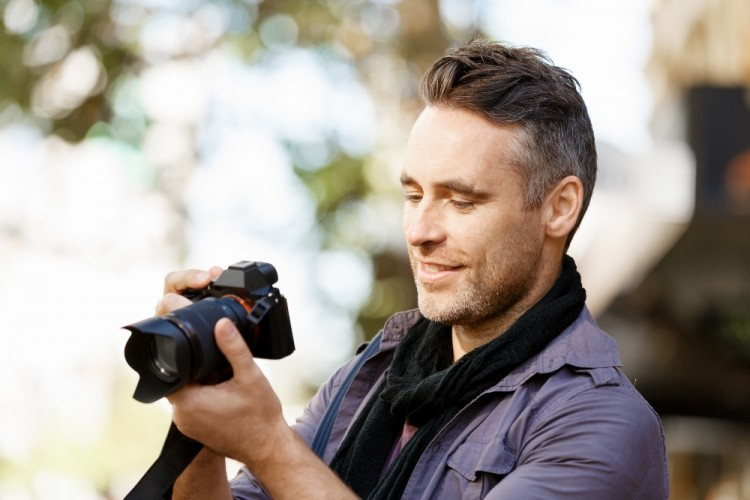 https://elements.envato.com/male-photographer-taking-picture-PVWJX9R